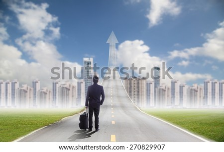 Businessman standing for going forward to investment city area for success his target in new city - stock photo