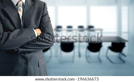 Businessman standing in a conference room  - stock photo