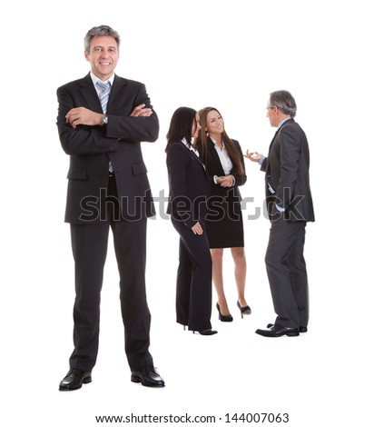 Businessman Standing In Front Of His Colleagues Over White Background - stock photo