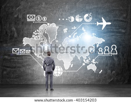 Businessman standing in front of map drawn on blackboard, money, people and communication pointsvand plane  on it. Concept of business logistics. - stock photo