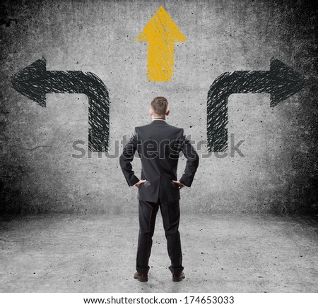 Businessman standing in front of the choice - stock photo