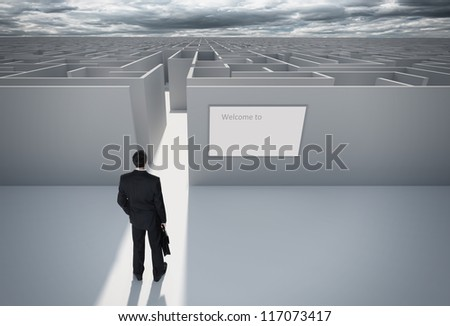 """Businessman standing in front of the entrance to the maze. Make a decision. Achieving the goal. With the sign """"Welcome"""" on the wall. Wide angle. - stock photo"""