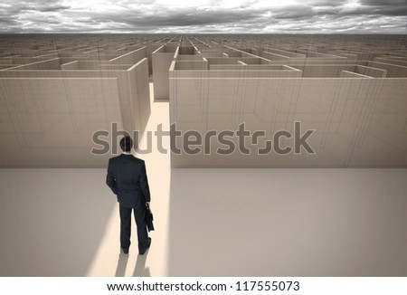 "Businessman standing in front of the entrance to the maze. Make a decision. Achieving the goal. Without the sign ""Welcome"" on the wall. Wide angle. Blueprint. Encounter difficulties - stock photo"