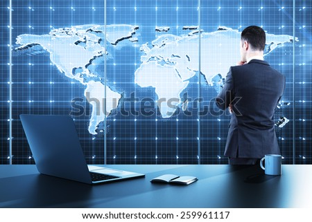 businessman standing in modern office and looking to global business map - stock photo