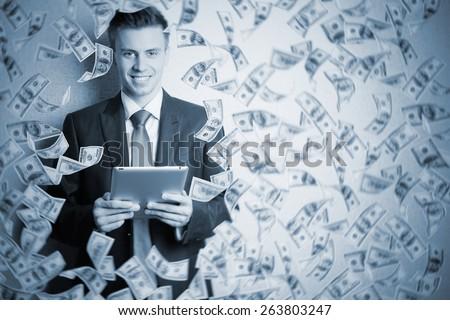 Businessman standing in the rain of money - stock photo