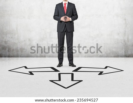 businessman standing on a cross road - stock photo