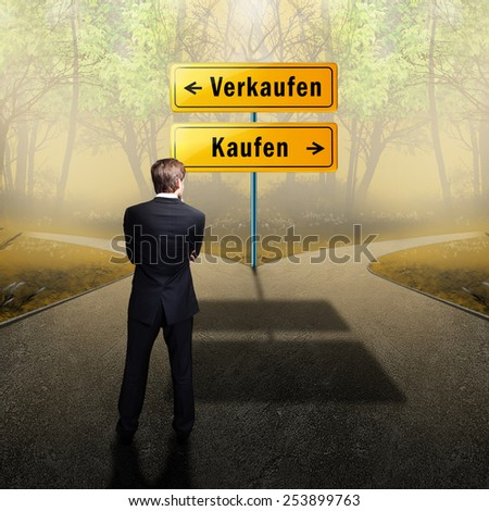 businessman standing on a crossroad, having to choose the right path what to do (with the words sell and buy in German) - stock photo
