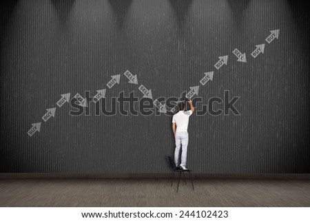 businessman standing on chair and drawing stock chart - stock photo