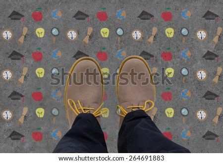 businessman standing on drawing education symbol on floor - stock photo