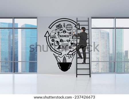businessman standing on ladder drawing sign in form lightbulb - stock photo