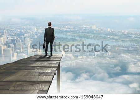 businessman standing on pier an looking on city - stock photo