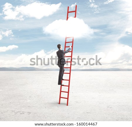 businessman standing on red ladder and looking to sky - stock photo