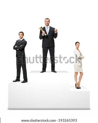 Businessman standing on the winners podium with his trophy. - stock photo