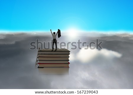 Businessman standing on top of stack of books with cloudy below and blue sky, sunlight - stock photo