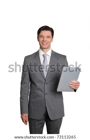 Businessman standing on white background with electronic tablet - stock photo