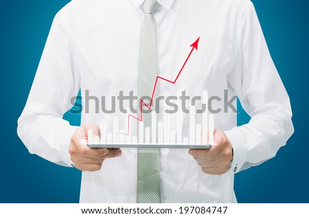 Businessman standing posture hand graph on tablet isolated on blue background - stock photo