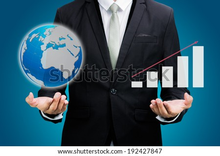 Businessman standing posture hand hold laptop showing graph isolated on over blue background - stock photo