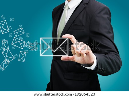 Businessman standing posture hand hold mail icon isolated on over blue background - stock photo