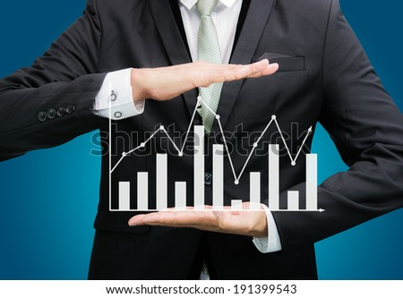 Businessman standing posture hand holding graph finance isolated on over blue background - stock photo
