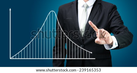 Businessman standing posture hand touch graph finance isolated on dark background - stock photo