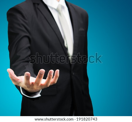 Businessman standing posture show hand isolated on over blue background - stock photo