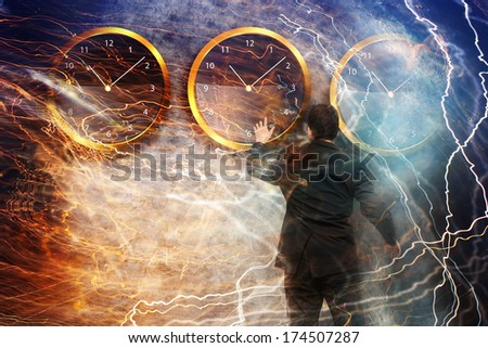 Businessman standing - time strategy concept with lightnings - stock photo