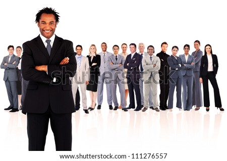Businessman standing while smiling against a white background - stock photo