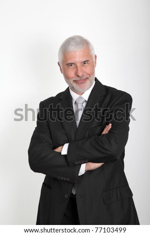 Businessman standing with arms crossed - stock photo