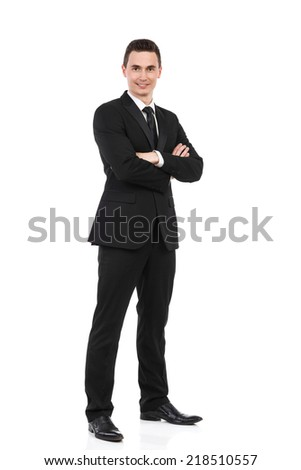 Businessman standing with arms crossed. Happy young office worker waiting with arms crossed. Full length studio shot isolated on white. - stock photo