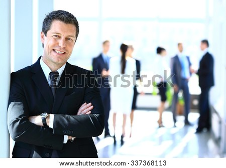 businessman standing with his team - stock photo