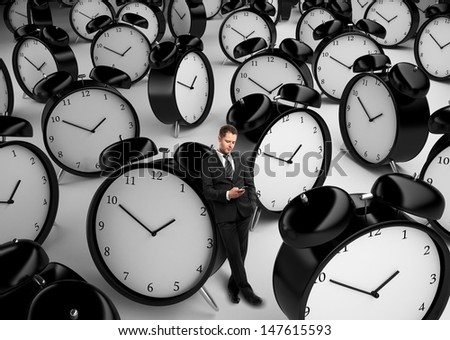 businessman standing with phone and many clock - stock photo