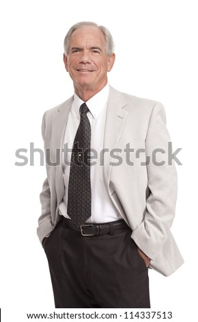 Businessman stands with hands in pockets - stock photo