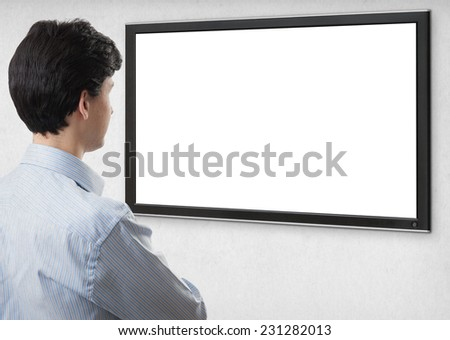 businessman staring at tv with blank screen for copy space. Rear view. Isolated on white - stock photo