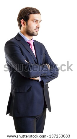 Businessman staring with arms crossed isolated on white - stock photo