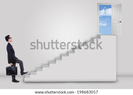 Businessman stepping up to the door on the sky with an arrow direction to the door - stock photo