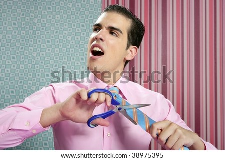 Businessman stressed with scissors trying to cut his tie - stock photo