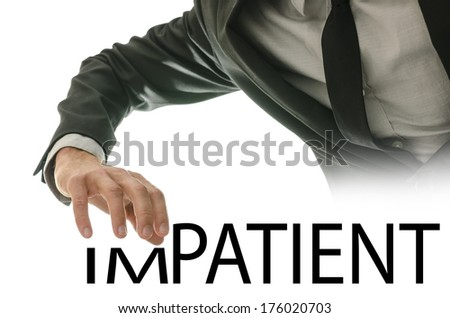 Businessman stretching his hand over the word Impatient - Patient in a conceptual image of opposite characteristics and personalities, of patience versus impatience. - stock photo