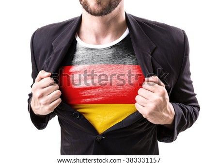 Businessman stretching suit with German Flag isolated on white background - stock photo