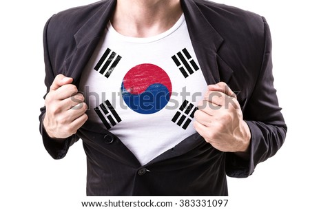 Businessman stretching suit with South Korean Flag isolated on white background - stock photo