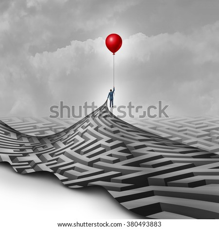 Businessman success concept as a metaphor to overcome obstacles as a person lifting a maze or labyrinth using a red balloon as a symbol for vision and finding a way to succeed. - stock photo