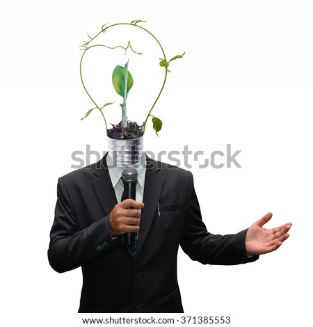 businessman Suit holding microphone and green energy light bulb head - stock photo