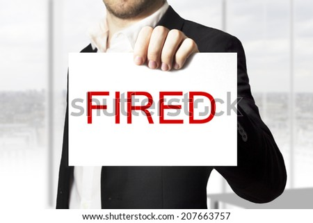 businessman suit holding sign fired - stock photo
