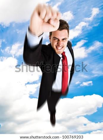 Businessman superhero flying above a city - stock photo
