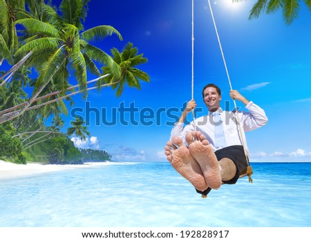 Businessman swinging at tropical beach. - stock photo