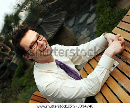 Businessman takes a break from work - happy and successful - stock photo