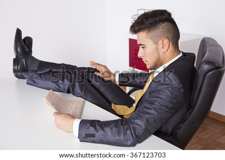 Businessman taking a break at his office - stock photo