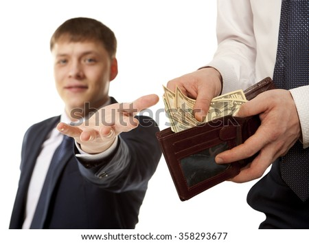 Businessman taking bribe over white background.  Business concept - stock photo