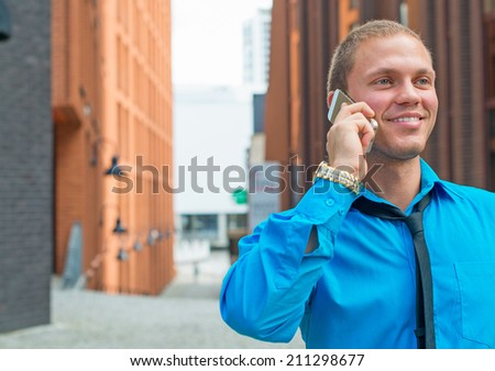 Businessman talking on the mobile phone outdoors. Place for text. - stock photo
