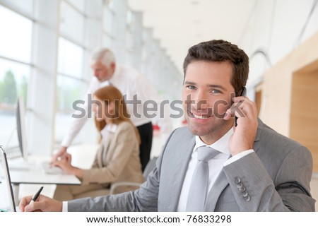 Businessman talking on the phone - stock photo