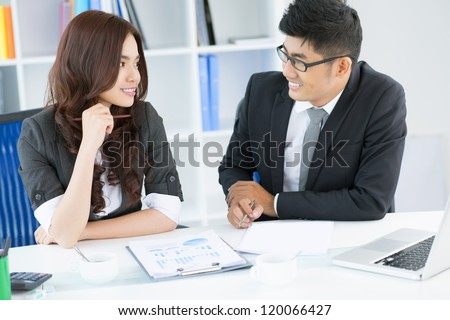 Businessman talking with a young attractive employee - stock photo